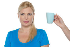 Woman is being offered a cup of beverage Royalty Free Stock Images