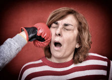 Woman being punched in her face Stock Images
