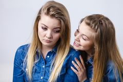 Woman being sad her friend comforting her. Woman being sad her female friend comforting her, helping during sadness or depression Stock Photos