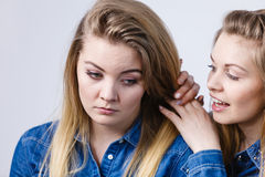 Woman being sad her friend comforting her. Woman being sad her female friend comforting her, helping during sadness or depression Royalty Free Stock Photography