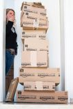 Woman being shocked by Amazon.com delivery Stock Image