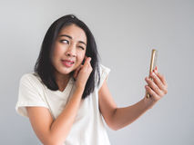 Woman being shouted from smartphone. Royalty Free Stock Image