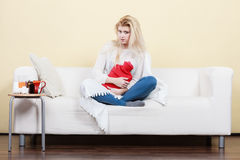 Woman being sick having flu lying on sofa Stock Photography