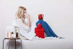Woman being sick having flu lying on sofa Royalty Free Stock Images