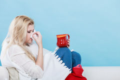 Woman being sick having flu lying on sofa Royalty Free Stock Photography