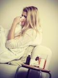 Woman being sick having flu lying on sofa Royalty Free Stock Photos