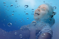 Woman being strangled under the water Stock Images