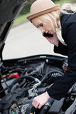 Woman being talked through roadside assistance Stock Photo