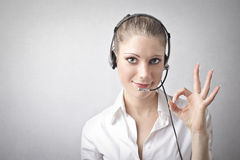 Woman being a telephone operator Royalty Free Stock Photos