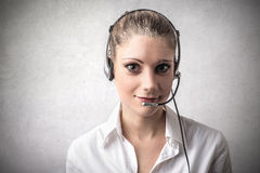 Woman being a telephone operator Stock Photo
