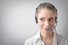 Woman being a telephone operator Stock Photos