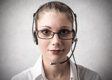 Woman being a telephone operator Stock Image