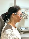 Woman being tested for glasses at an optometrist stock image