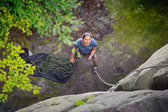 Woman belaying another climber with rope Royalty Free Stock Images