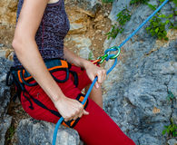 Woman belays climber Royalty Free Stock Photo
