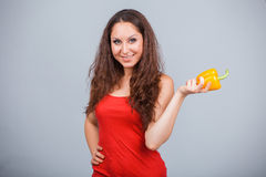 Woman with bell pepper Stock Photography