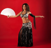 Woman belly dance with fan Royalty Free Stock Images