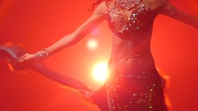 Woman belly dancer arabian in exotic dress dancing. Red smoke background. Slow motion. Close up. Woman belly dancer arabian in exotic dress dancing exotic dance stock footage