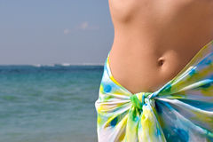Woman belly and ocean Royalty Free Stock Images