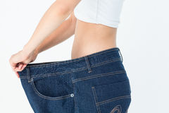 Woman belly in too big pants Stock Images