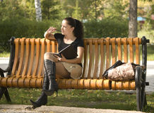 Woman on bench Stock Images