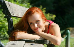 Woman on bench Royalty Free Stock Image