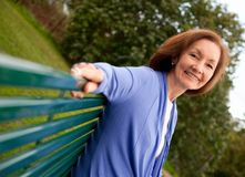 Woman on a bench Royalty Free Stock Images