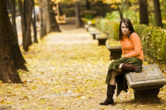 Woman in bench Royalty Free Stock Photo