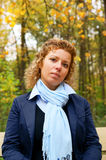 Woman on bench in autumn park Royalty Free Stock Photos