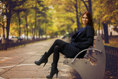 woman on the bench in autumn park Royalty Free Stock Photography