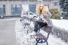 Woman on a bench in the city Stock Photography