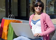 woman on bench with laptop Stock Images