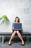 Woman on bench with laptop Stock Photo
