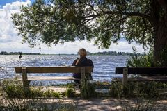 Woman on a bench Stock Images