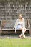 Woman on bench. Portrait of a pretty woman sitting on a bench Royalty Free Stock Image