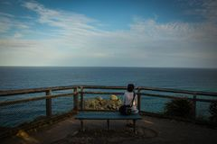 Woman on bench with seascape royalty free stock images