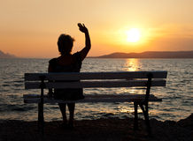 Woman and sunset Stock Photography