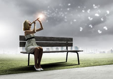 Woman on bench Stock Photography