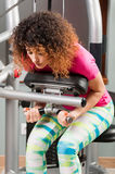 Woman bending and doing abdominal training Royalty Free Stock Photo