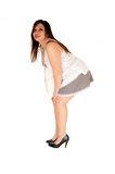 Woman bending down. Royalty Free Stock Image