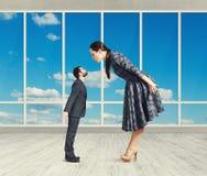 Woman bending forward and kissing Royalty Free Stock Image