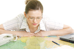 Woman bending over map Stock Photography