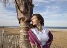 Woman. Bending on a palm tree Stock Photos