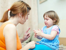 Woman berates baby in home Royalty Free Stock Photo