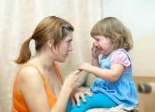 Woman berates crying baby Royalty Free Stock Photo