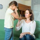 Woman berating crying daughter Royalty Free Stock Image
