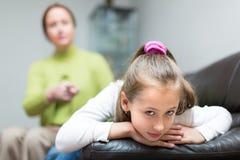 Woman berating daughter in home Royalty Free Stock Image