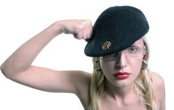 Woman in beret. Woman in a beret with her fist against her head royalty free stock photos