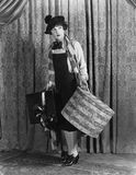 Woman in a beret holding a hat box and presents. (All persons depicted are no longer living and no estate exists. Supplier grants that there will be no model royalty free stock images