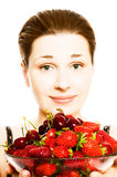 Woman with berries. Royalty Free Stock Photography